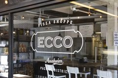 Signe de restaurant de magasin de pizza d'Ecco images libres de droits