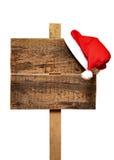 Signe de route avec le chapeau de Santa Images libres de droits
