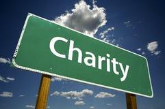 Signe de route de charité. photos libres de droits