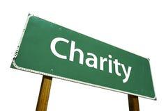 Signe de route de charité. Photographie stock