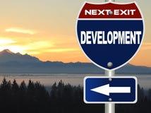 Signe de route de développement Image stock