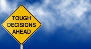 Signe de route de décisions difficiles en avant Photo libre de droits