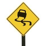 Signe de route glissant jaune. photos libres de droits