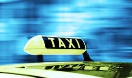 Signe de taxi Photographie stock