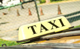 Signe de taxi Photos stock