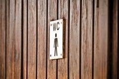 Signe de toilettes pour des messieurs, fin  photographie stock libre de droits