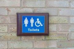 Signe de toilettes pour les toilettes publiques Image libre de droits