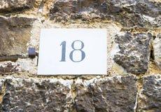 Signe du numéro de maison 18 photos stock