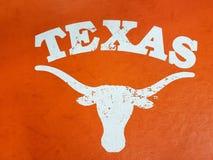 Signe du Texas et visage de taureau avec le fond d'orange de klaxons photographie stock