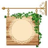 Signe en bois avec le lierre Image stock