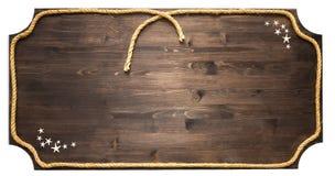 Signe en bois vide avec la corde d'isolement sur le fond blanc Photographie stock libre de droits