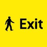 Signe jaune de sortie de secours Photographie stock libre de droits