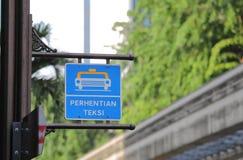 Signe Kuala Lumpur Malaysia de support de taxi photos libres de droits