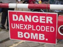 Signe non explosé de bombe de danger Image libre de droits