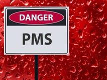 Signe PMS et baisse rouge de sang sur le verre photo libre de droits