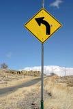 Signe pointu de virage à gauche Image libre de droits