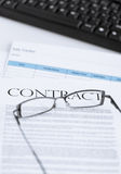 Signed contract paper with glasses Stock Images