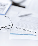 Signed contract paper with glasses Stock Photo