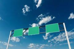 Signes au-dessus de la route Photographie stock