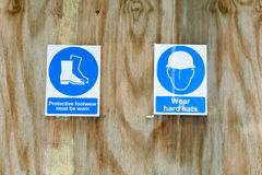 Signes de santé et sécurité de chantier de construction Photo libre de droits