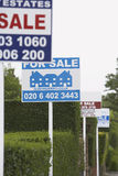 Signes de vente de Real Estate Images libres de droits