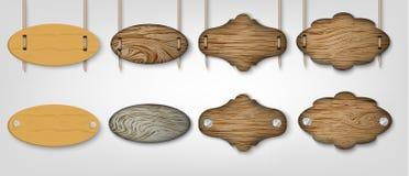 Signes en bois avec l'herbe Images stock