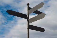 Signes en métal de route de direction Image libre de droits