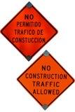 Signes non autorisés de construction anglais et espagnols photographie stock libre de droits