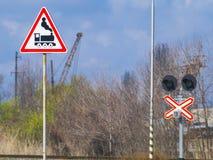 Signes réglés au passage à niveau Images libres de droits