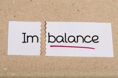 Signez avec le déséquilibre de mot transformé en équilibre photos stock