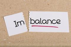 Signez avec le déséquilibre de mot transformé en équilibre photo libre de droits