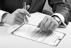 Signing. Monochrome photo. Notary signing a power of attorney, focus is on the tip of the pen. Document was created by the photographer royalty free stock photo