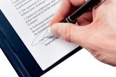 Signing an agreement (contract) Royalty Free Stock Image