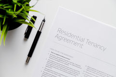 Signing of agreement top view on white background Royalty Free Stock Photo