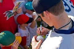 Signing Autographs stock image