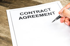 Signing on blank contract agreement paper Stock Images