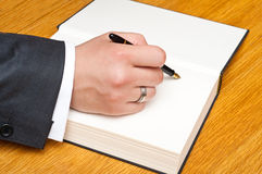 Signing a book Royalty Free Stock Photos