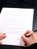 Signing a business contract Royalty Free Stock Photos