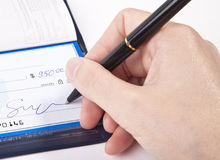 Signing a check. Signing a personal check close up Stock Images