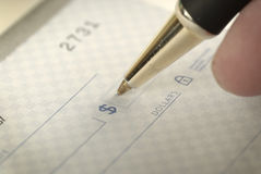 Signing a Check for Personal Finances Stock Images