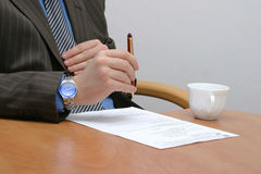 Before signing the contract. Businessman is about of signing the contract stock photos