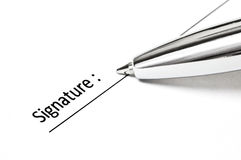Signing contract. Photo of a pen ready to sign Royalty Free Stock Images