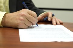 Signing a contract. Business man signing a contract stock photography