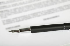 Signing of contract. This image shows a fountain pen on a contract sheet Royalty Free Stock Photos