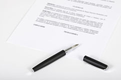 Signing of contract. This image shows a fountain pen on a contract sheet Stock Images