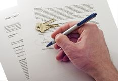 Signing contract. Signing mortgage contract isolated on white Royalty Free Stock Images