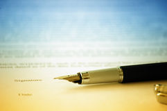 Signing contract. Close-up of a fountain pen over a business contract to be signed Royalty Free Stock Image