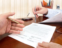 Signing a contract. Male hands with pens signing a contract Stock Photos