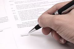 Signing contract. Close up of businessman signing a contract Royalty Free Stock Photo