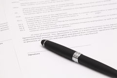 Signing contract. Close up of businessman signing a contract Royalty Free Stock Images